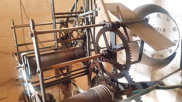 The clock mechanism which operates some of the bells in the right-hand belfry.