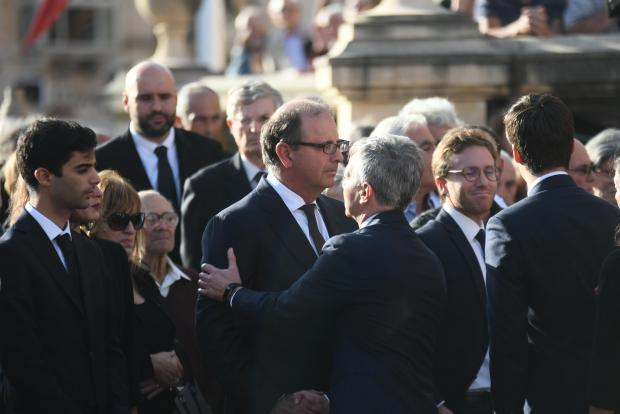 Daphne Caruana Galizia's husband (centre) and son (left) during the funeral in 2017.