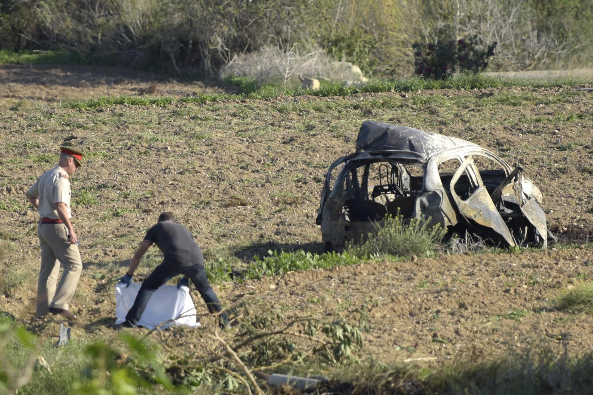 The aftermath of the car bomb that killed Daphne Caruana Galizia in October 2017