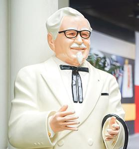 Colonel Harland Sanders' statue in front of Kentucky Fried Chicken outlet.