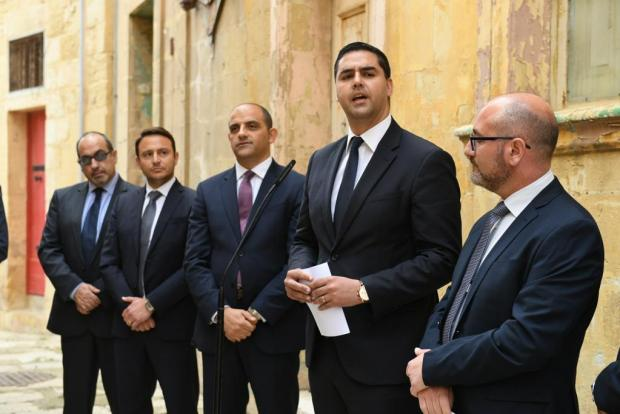 Infrastructure Minister Ian Borg (second from right) outside the Birgu property being transformed into social housing.