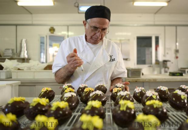 75-year-old Carmelo Borg Bonaci decorates Easter eggs at Elia Caterers in Hamrun on March 2. Photo: Matthew Mirabelli