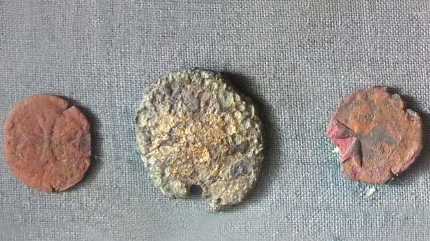 Three of the coins found – two of bronze and one of gold.