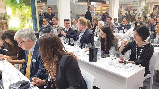 Members of the wine press examine Medina Chardonnay Girgentina at Vinitaly.
