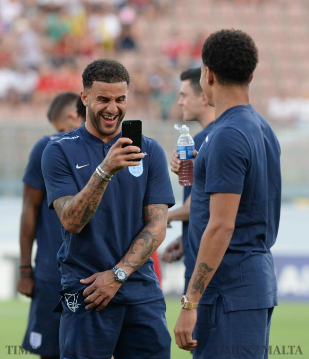 England's Kyle Walker takes a photo of fellow teammate Dele Alli before their FIFA 2018 World cup Qualifying Group F Match at the National Stadium in Ta'Qali on September 1. Photo: Matthew Mirabelli