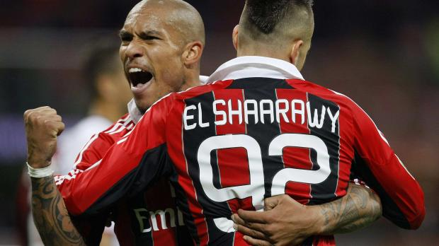 Milan's Stephan El Shaarawy is embraced by his team mate Nigel De Jong after scoring against Genoa during their Italian Serie A soccer match at the San Siro stadium in Milan. Photo: Alessandro Garofalo, Reuters