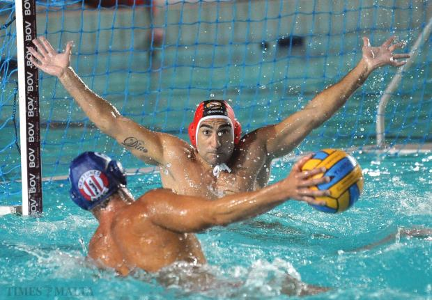 San Giljan goalkeeper Dino Camilleri stretches every muscle to prevent Alexander Ciric of Neptunes from scoring during their crucial BOV National League match at the National Pool on August 31. Neptunes beat San Giljan 9-8 to force a decider. Photo: Chris Sant Fournier