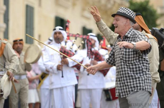 Members of the Abu Dhabi Police Force Band encourage a passer by to participate with them in St George's Square, Valletta on October 11. Photo: Matthew Mirabelli