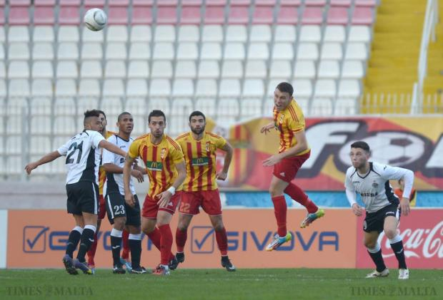 Birkirkara's Ryan Camenzuli (2nd right) heads the ball during their Premier League match against Hibernians at the National Stadium in Ta'Qali on January 24. Photo: Matthew Mirabelli