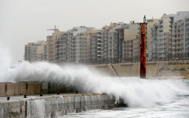 A wave crashes over the breakwater at the entrance to the Portomaso Marina as strong winds continued to hit the island on January 4. Photo: Matthew Mirabelli