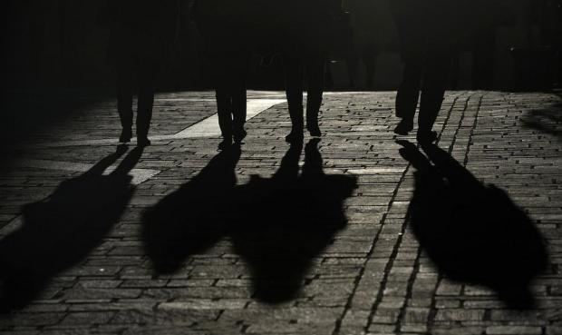 A group of four people are silhouetted by the afternoon sun in Valletta on January 10. Photo: Matthew Mirabelli