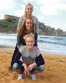 Julia, 11 (bottom), who suffers from coeliac disease, and her sisters Martina, 15, and Thea, 17.