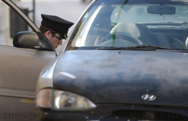 A policeman searches a car involved in a hit and run accident in Hamrun on January 3. Photo: Matthew Mirabelli