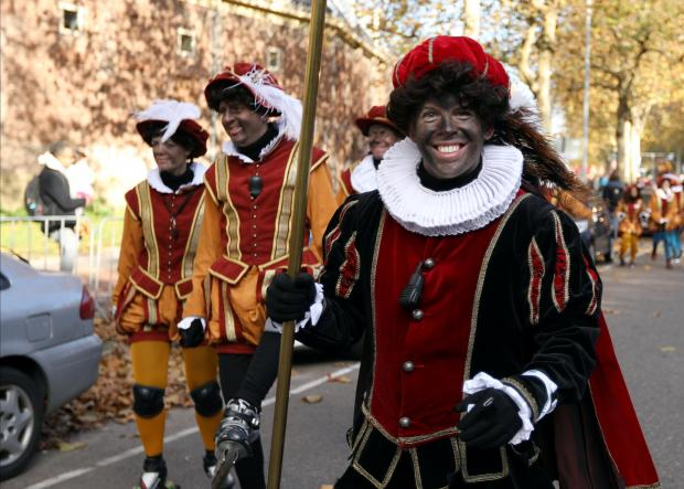 """""""Zwarte Piet"""" (Black Pete), who are a Saint Nicholas' assistants are seen during a traditional parade in Amsterdam. Photo: Reuters"""