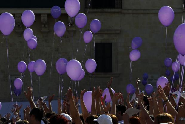 Participants in the President's Solidarity Fun Run 2015 hold balloons at the end of the event at St George's Square in Valletta on November 15. Photo: Darrin Zammit Lupi