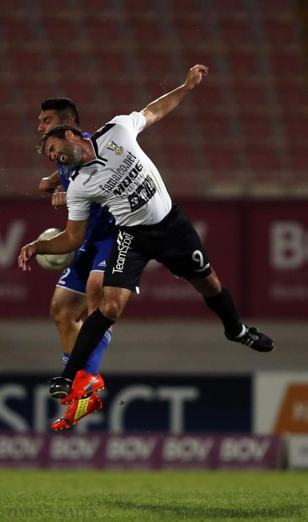 Pieta Hotspurs' Malcolm Licari (front) and Mosta's Tyrone Farrugia clash in an aerial duel during their Premier League match at the National Stadium in Ta' Qali on August 24. Photo: Darrin Zammit Lupi