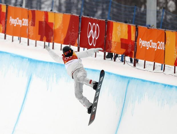 Shaun White has won a third successive Olympic gold medal after winning the halfpipe event.