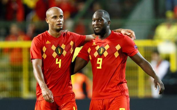 Romelu Lukaku (right) celebrates his goal with Vincent Kompany.