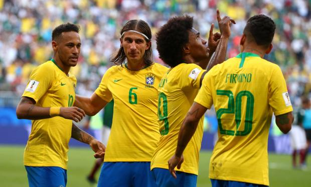 Brazil's Roberto Firmino celebrates scoring their second goal with Neymar, Filipe Luis and Willian.