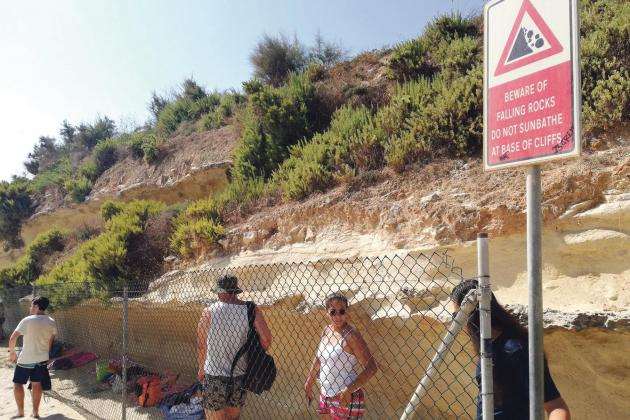 Beachgoers at St Peter's Pool ignore danger signs for shade at cliff face