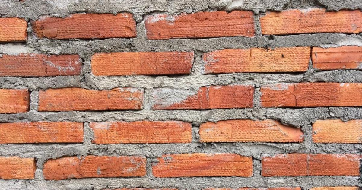 Man wakes up to find brick wall built in front of door