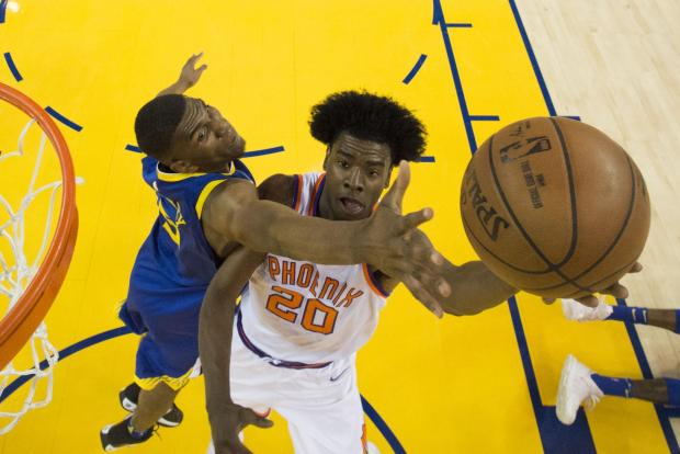 Phoenix Suns guard Josh Jackson (20) shoots the basketball against Golden State Warriors forward Kevon Looney (5) during the third quarter at Oracle Arena. The Warriors defeated the Suns 117-107. Photo Credit: Kyle Terada-USA TODAY Sports