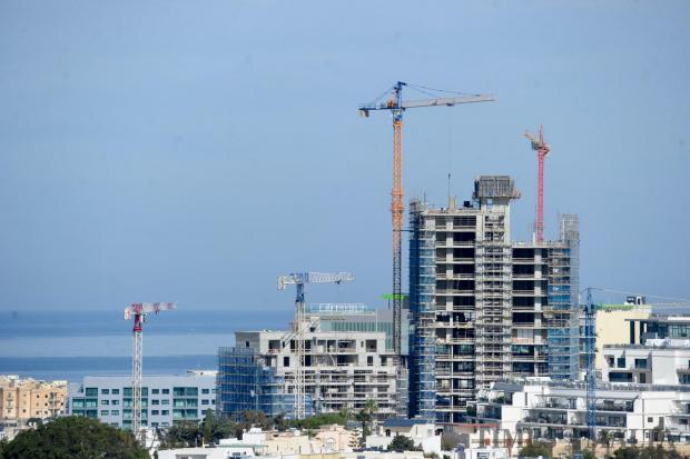 Cranes tower over a development in St Julian's on February 4. Photo: Steve Zammit Lupi