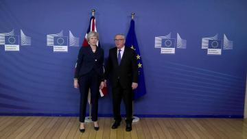 May, Juncker hold 'robust' Brexit meet, agree new talks