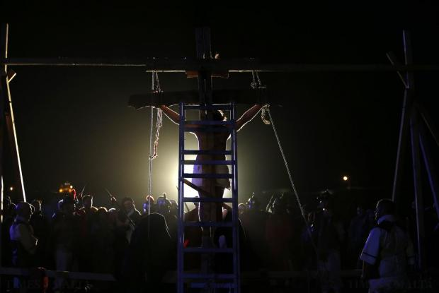 "Actors portraying a scene from the crucifixion of Christ take part in the interactive street-theatre performance of ""Il-Mixja"" in the grounds of Mount Carmel Mental Hospital in Attard on March 31. Photo: Darrin Zammit Lupi"