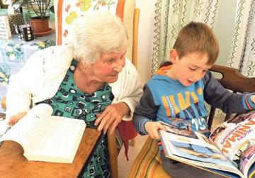 With her great-grandson Lukas during one of her daily reading sessions.