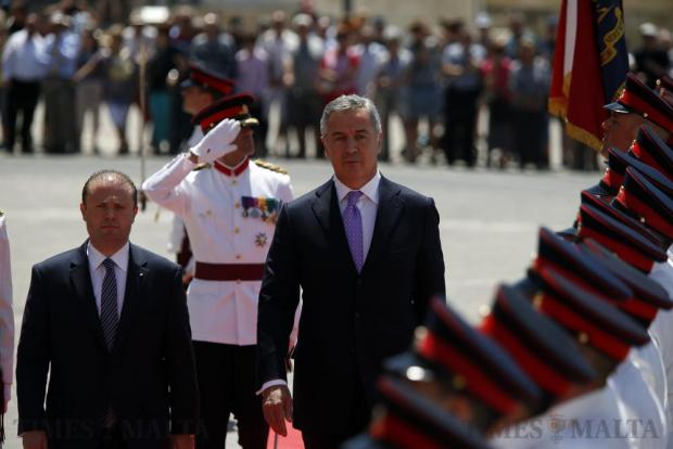Prime Minister Milo Djukanovic (centre) of Montenegro and Malta's Prime Minister Joseph Muscat inspect and Armed Forces of Malta guard of honour at Castille Place in Valletta on May 18. Photo: Darrin Zammit Lupi