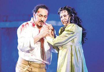 Cavaradossi (Stefano La Colla) is joined by Tosca (Amarilli Nizza) who informs him that Scarpia is dead and that he is to go through the supposedly mock shoot-out before they can escape with their safe conduct.
