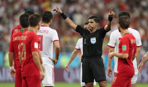 The referee gives Iran a last-minute penalty. Photo: Reuters