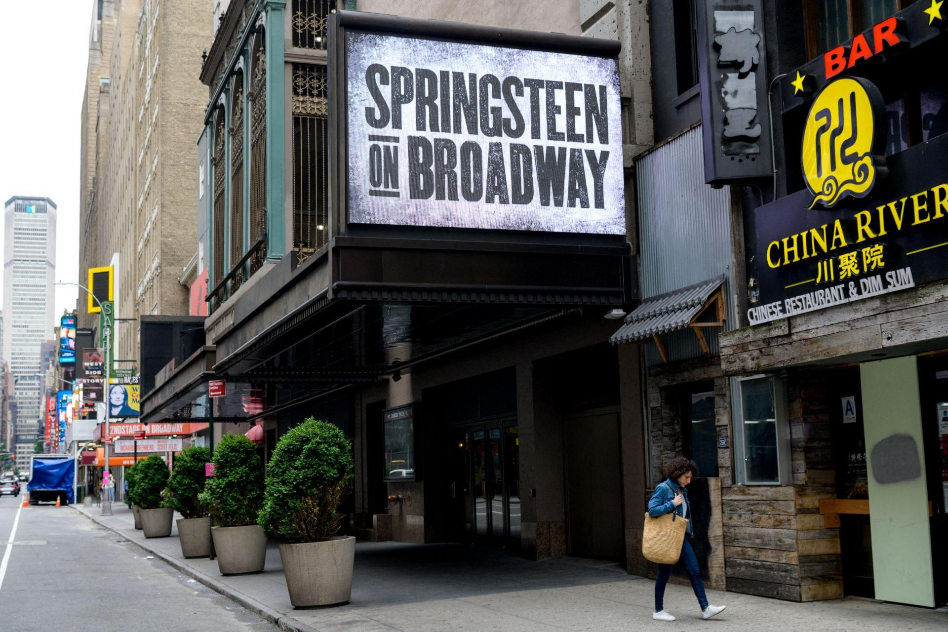 People walk past the St James Theatre after it announced Bruce Springsteen's return to Broadway on June 26th with 'Springsteen on Broadway' on June 11, 2021.