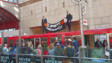 Watch: Climate protesters glue themselves to London train
