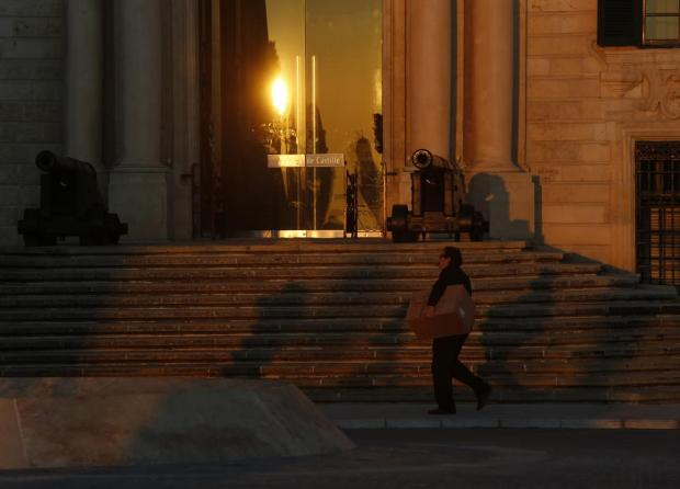 A man walks past the steps leading up to Auberge de Castille in Valletta at sunset on December 22. Photo: Darrin Zammit Lupi