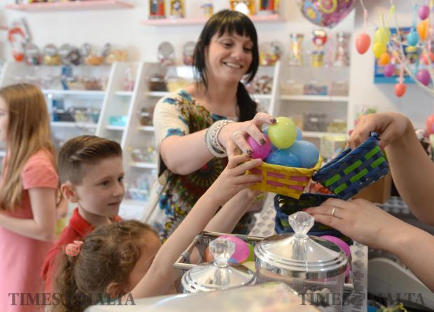 Children count their Easter eggs after an Easter egg hunt at Soho Sweet Shop in Attard on April 15. Photo: Matthew Mirabelli