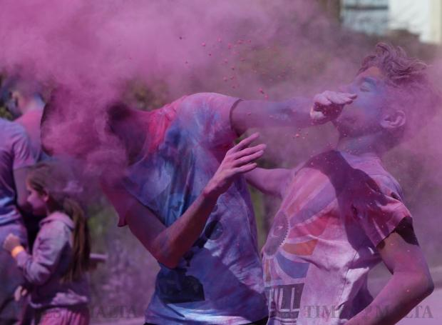 Participants throw coloured powder at each other during the Holi Festival of Colours organised by the Maltese-Indian community in Qormi on March 31. Photo: Darrin Zammit Lupi