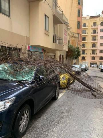 Steel mesh came crashing down onto cars parked in a Sliema road. Photo: Hilary Galea Lauri
