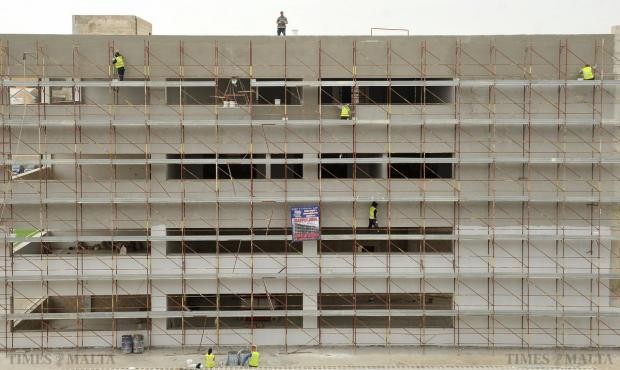 Construction workers walk along scaffolding at the new MCAST building in Corradino on March 26. Photo: Chris Sant Fournier