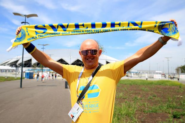 A Sweden fan shows his support outside the stadium prior to the FIFA World Cup, Quarter Final match at the Samara Stadium.