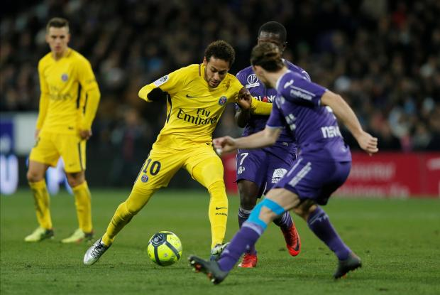 Paris Saint-Germain's Neymar in action with Toulouse's Yannick Cahuzac and Max Gradel.