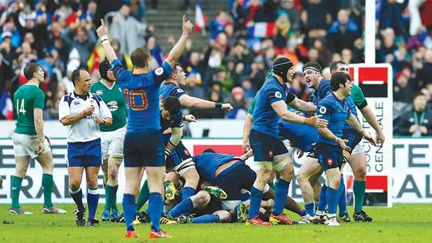 France celebrate their victory at the end of the match against Ireland, yesterday.