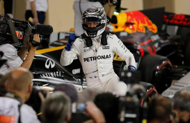Mercedes Formula One driver Valtteri Bottas of Finland celebrates his pole position.