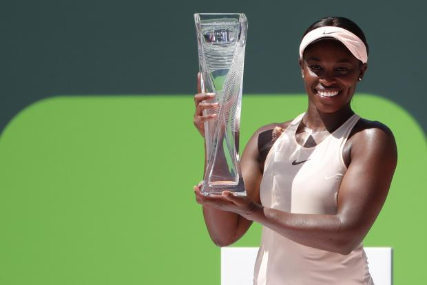 Sloane Stephens of the United States poses with the Butch Buchholz championship trophy after her match against Jelena Ostapenko of Latvia (not pictured) during the women's singles final of the Miami Open at Tennis Center at Crandon Park. Stephens won 7-6(5), 6-1. Photo Credit: Geoff Burke-USA TODAY Sports
