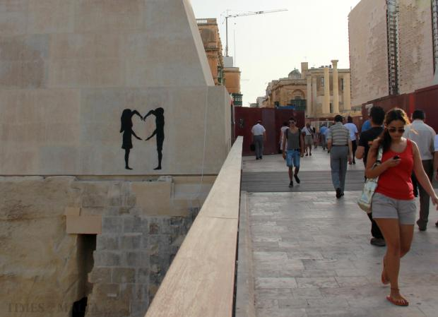 "Valletta's new City Gate became the target of a graffiti ""vandal"" who sprayed an image of two people on the iconic structure in the early hours of August 29. Photo: Paul Spiteri Lucas"