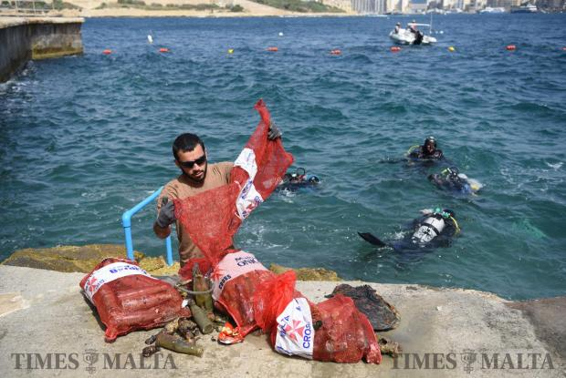 Volunteers clean the seabed in Valletta on June 7. Photo: Mark Zammit Cordina