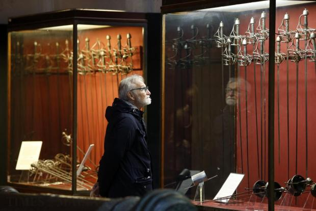 A man looks at a display of swords at the Palace Armoury in Valletta on December 8. Heritage Malta opened practically all its sites and museums for free for the day, in a bid to promote the island's rich historical, archaeological and artistic heritage. Photo: Darrin Zammit Lupi
