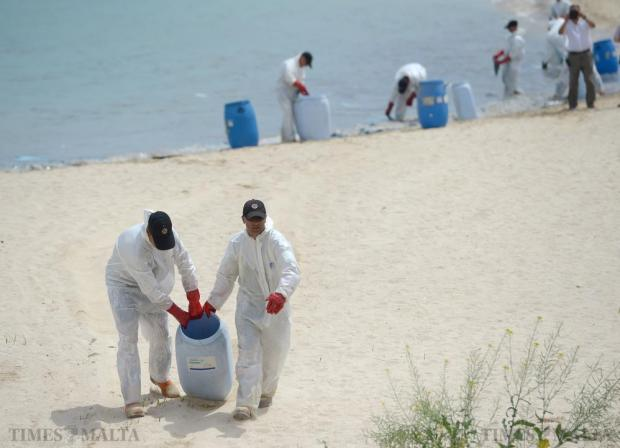 Members of Civil Protection carry attempt to clean Pretty Bay, in Birżebbuġa after it was closed to bathers on June 12 due to sizeable oil Spill. The spill was caused when a container was damaged by machinery in the Freeport, contaminated the water and sand. Photo: Matthew Mirabelli