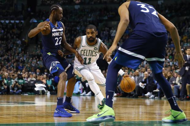 Boston Celtics guard Kyrie Irving (11) drives past Minnesota Timberwolves forward Andrew Wiggins (22) during the second half of Boston's 91-84 win at TD Garden. Photo: Winslow Townson-USA TODAY Sports